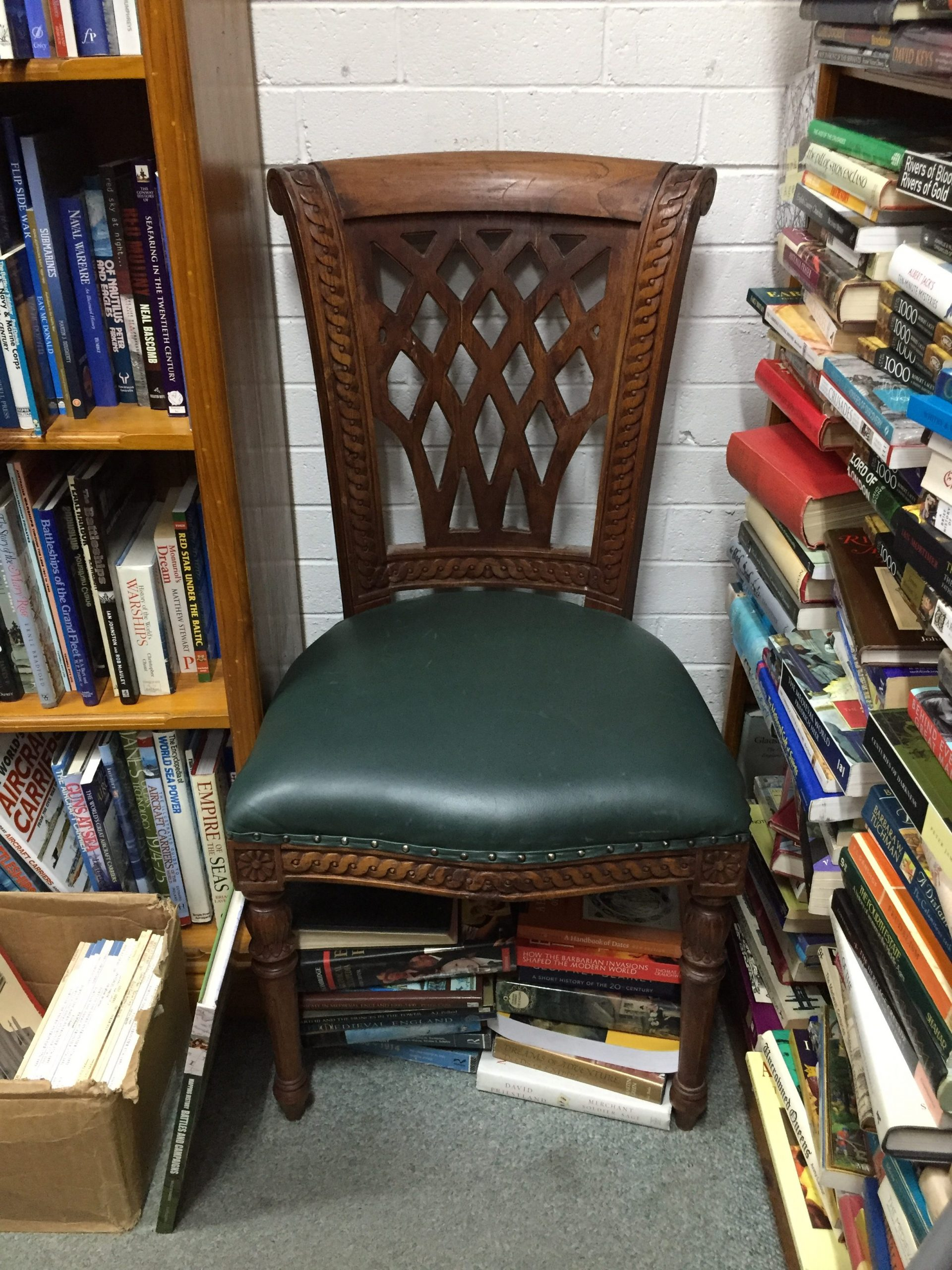 wooden-chair-in-book-shop